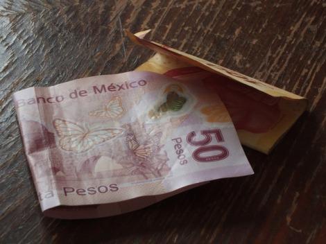 Money pesos bill, business finance.